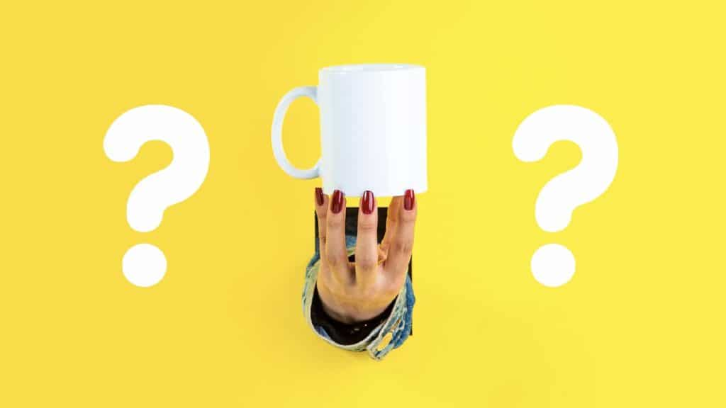 Question marks surround a hand holding a coffee cup. © PsyCat Games, 2020, under Creative Commons License 4.0. https://creativecommons.org/licenses/by-nc/4.0/
